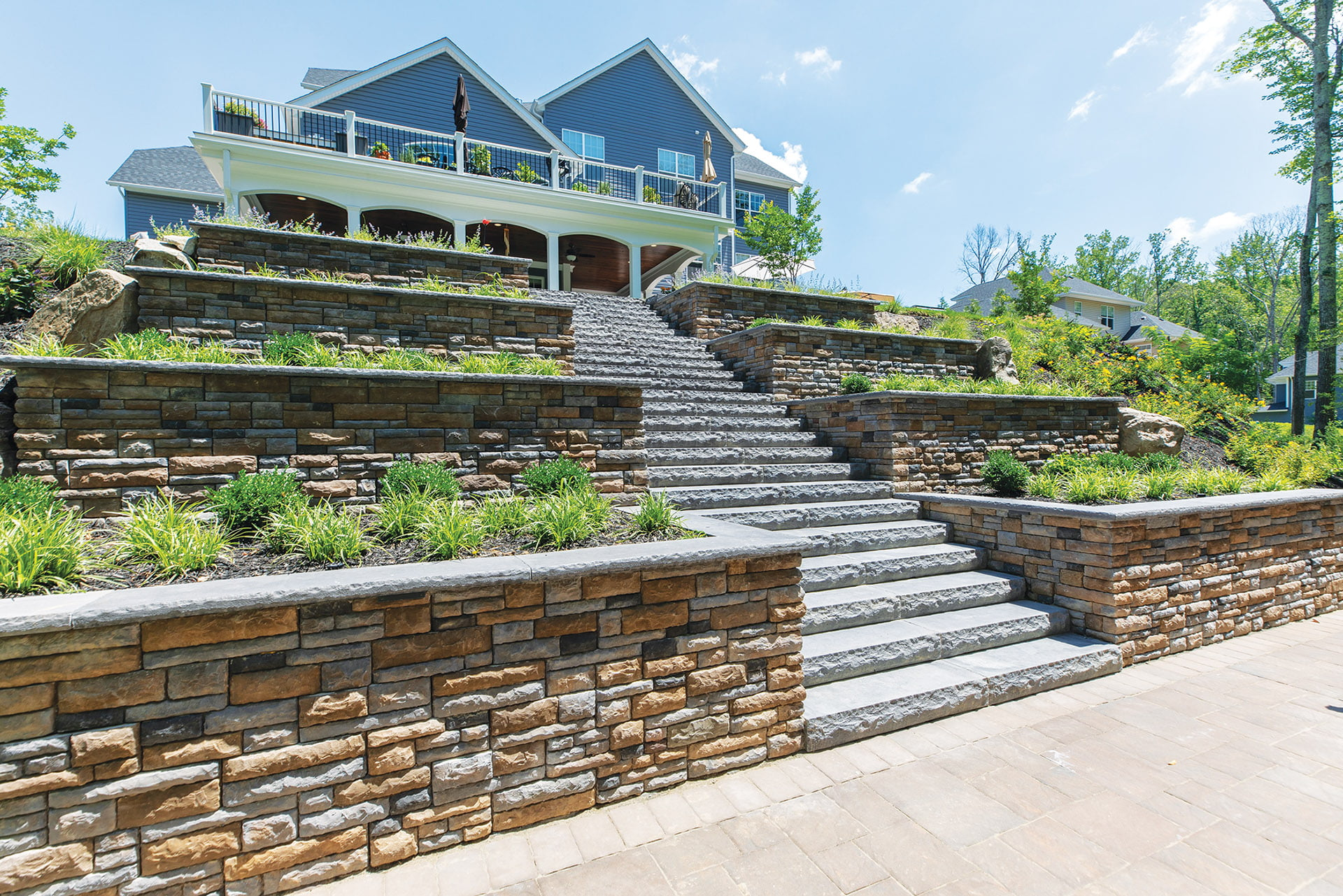 EP Henry cast-veneer stone and bluestone steppers, Scapes, Inc., designed terraced stairs