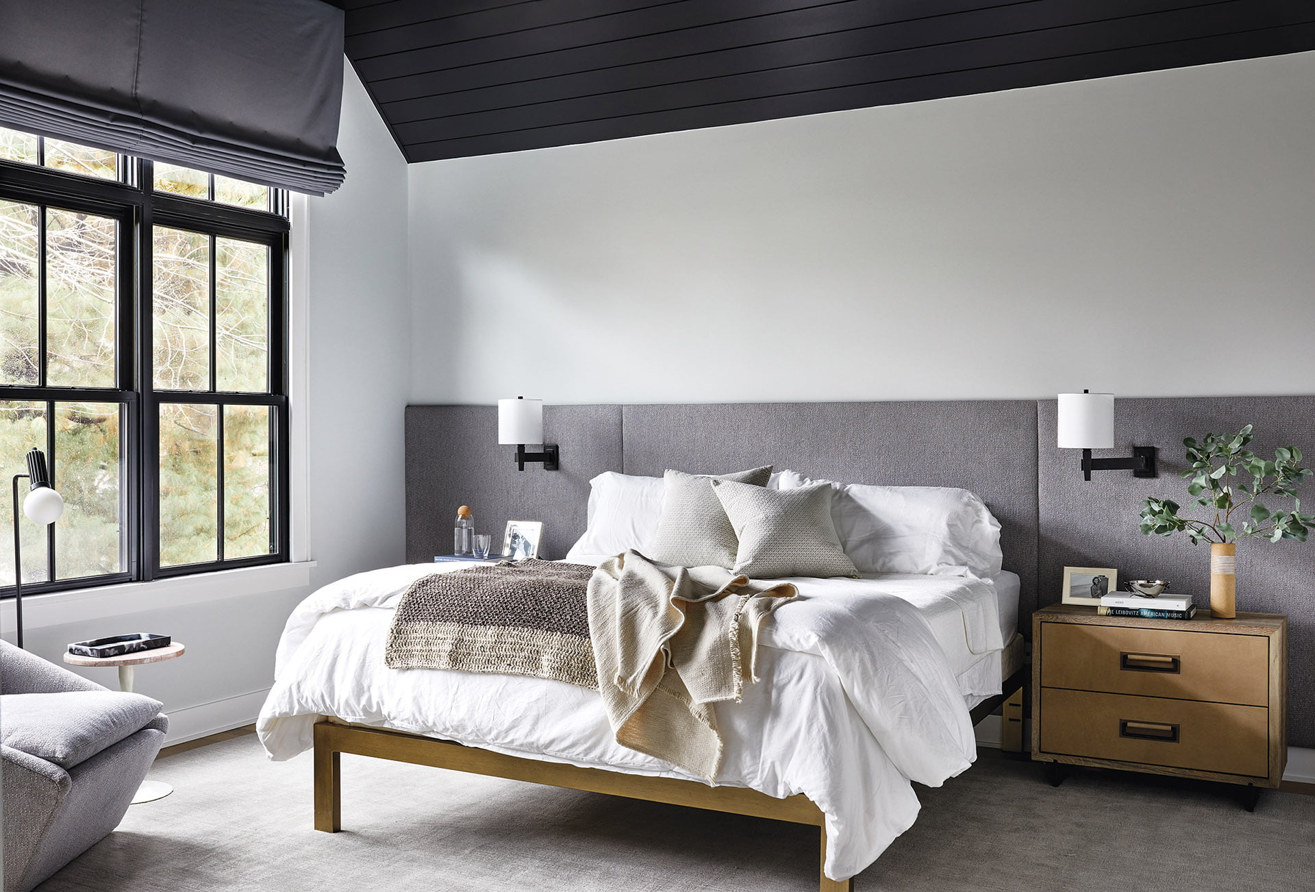 Rodolph fabric panels made by Flowers Upholstery anchors the owners bed