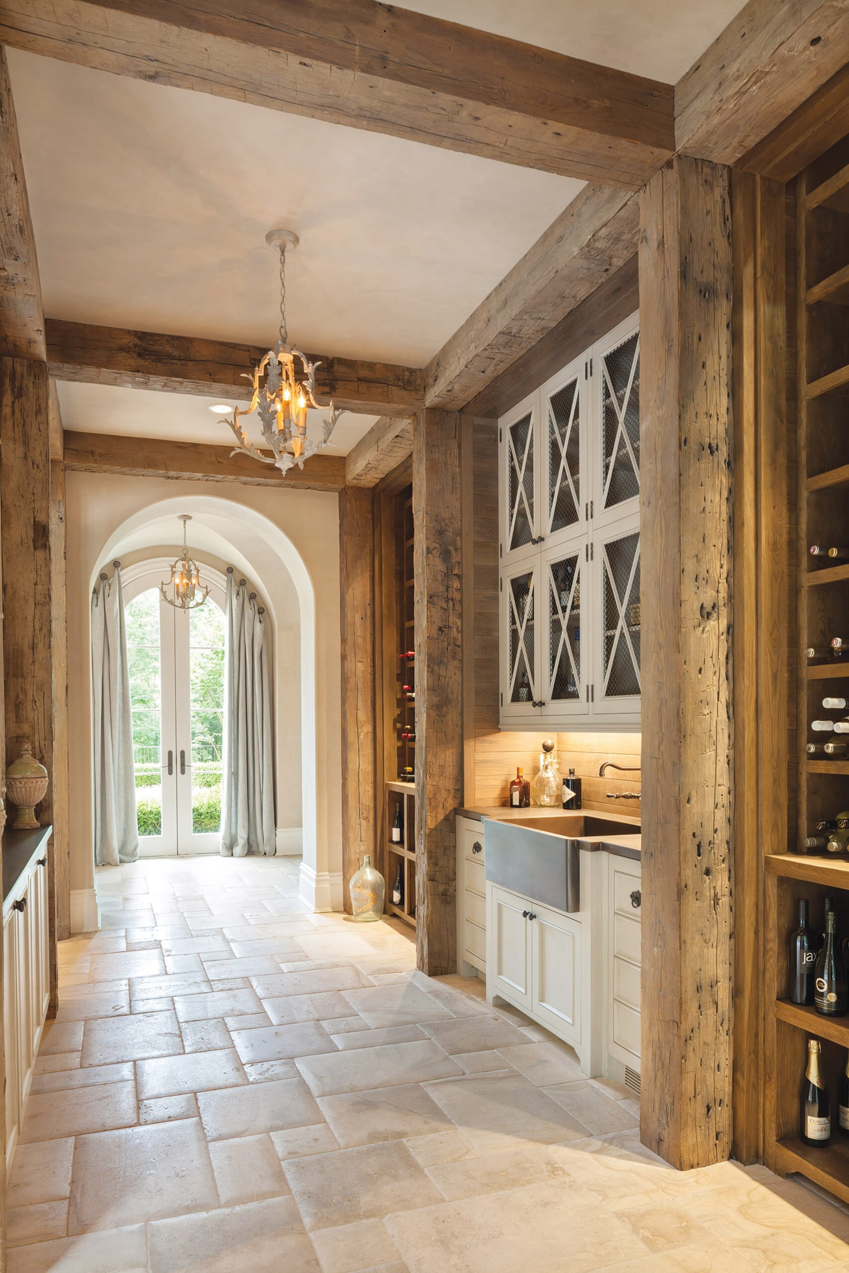 Century-old timbers enliven a bar and wine cellar tucked into a side hall.